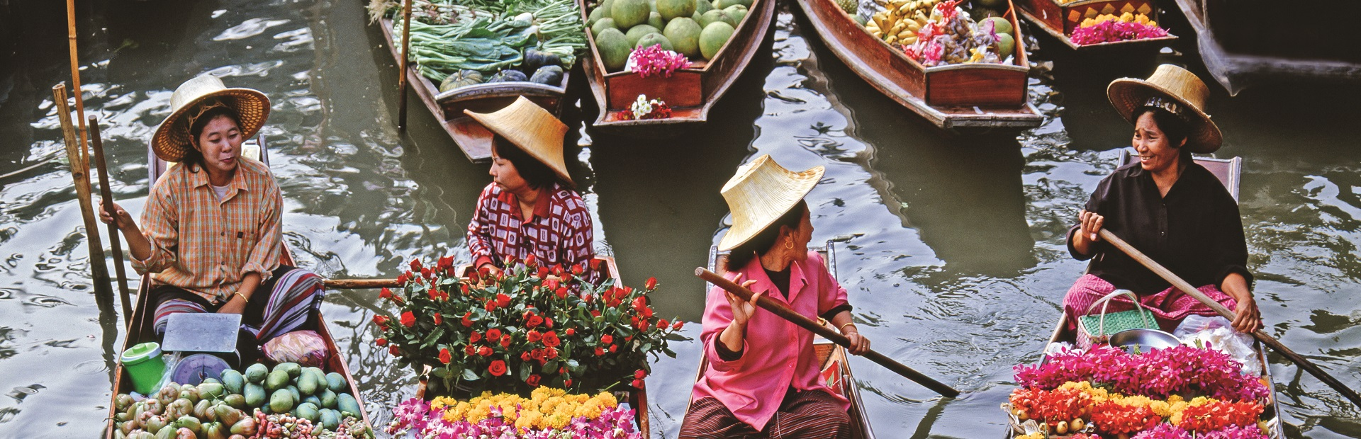 Women market traders in boats laden with fruit and flowers, Damn